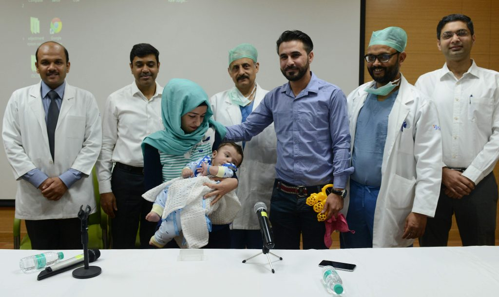Seven-month-old baby who was born with EIGHT LIMBS has successfully surgery Near Delhi