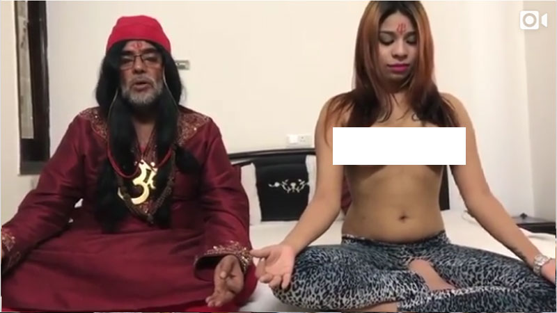 Swami Om teaches yoga to a topless girl in latest video