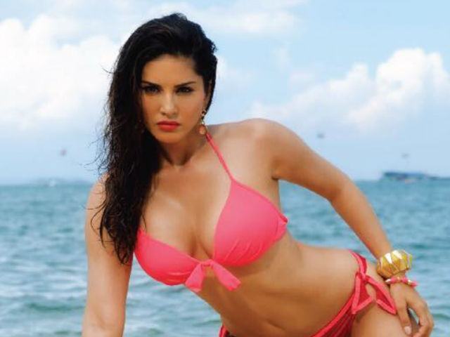IN Pics: Sunny Leone poses nude during hot photo shoot on a bed of red chillies for PETA