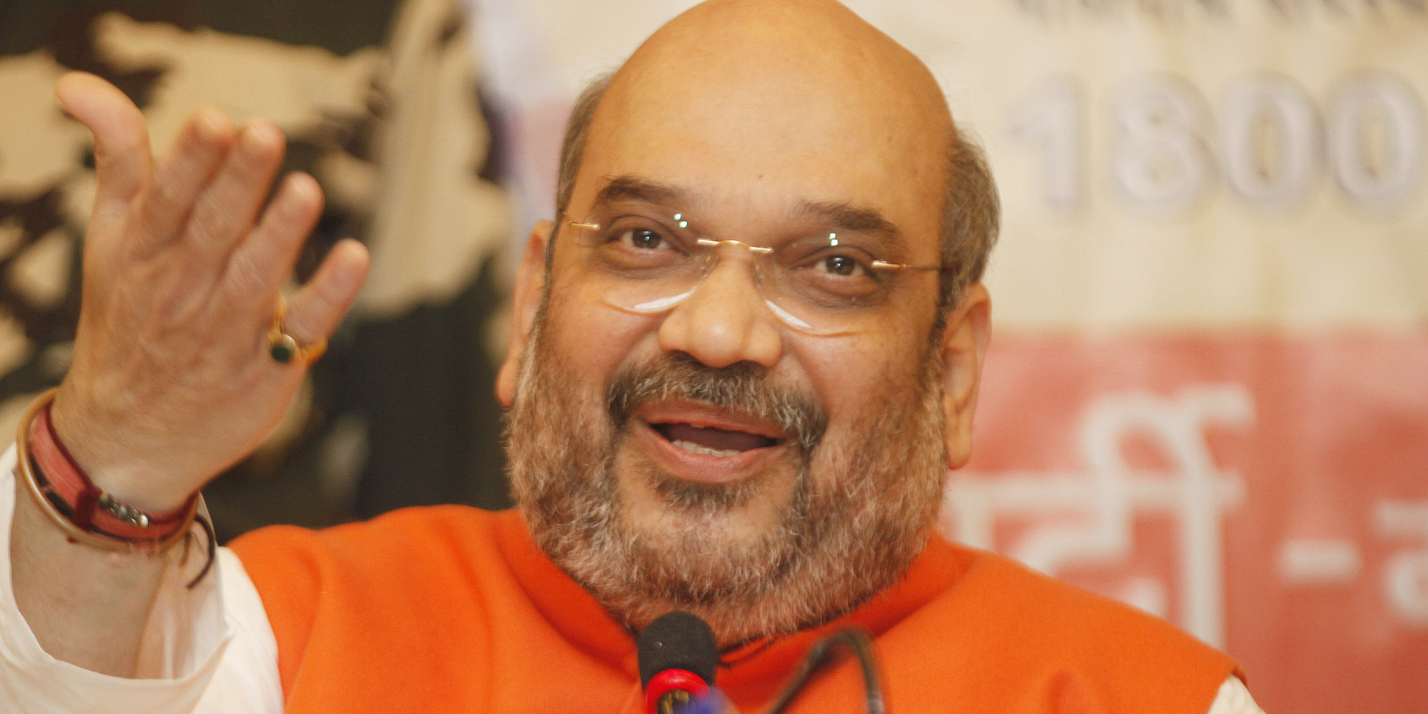 BJP Chief Amit Shah has lunch at BJP worker's house, interacts with family