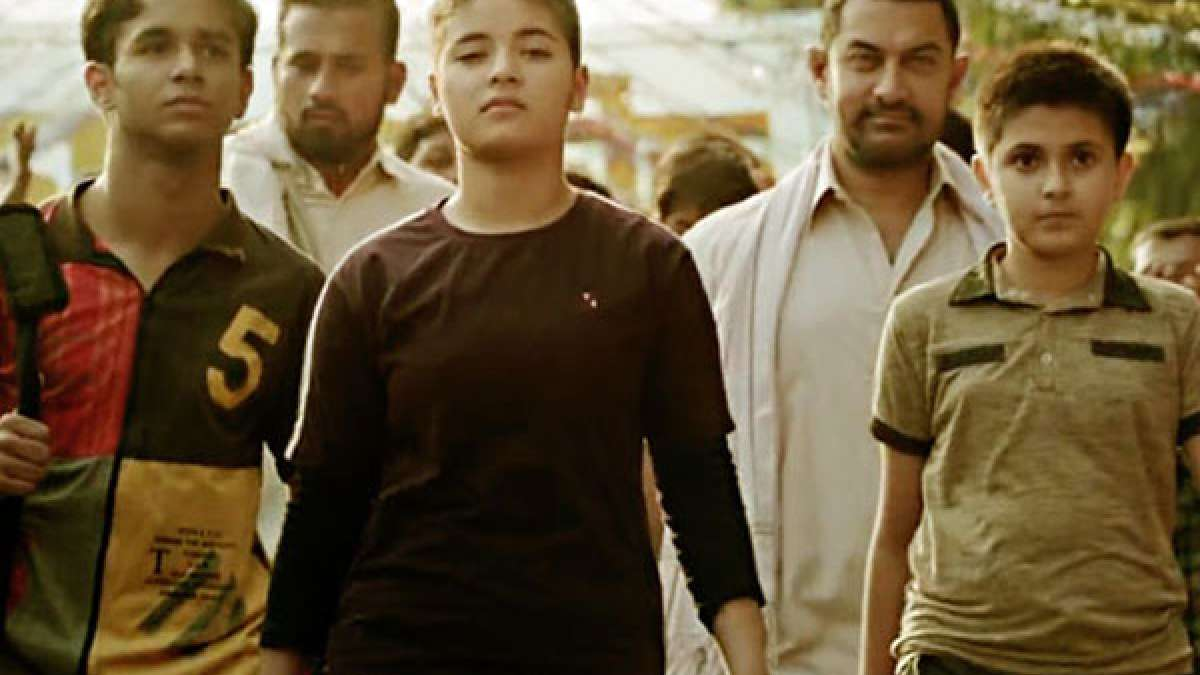 Screenshot from Dangal trailer showing Aamir Khan as wrestler Phogat with his daughters