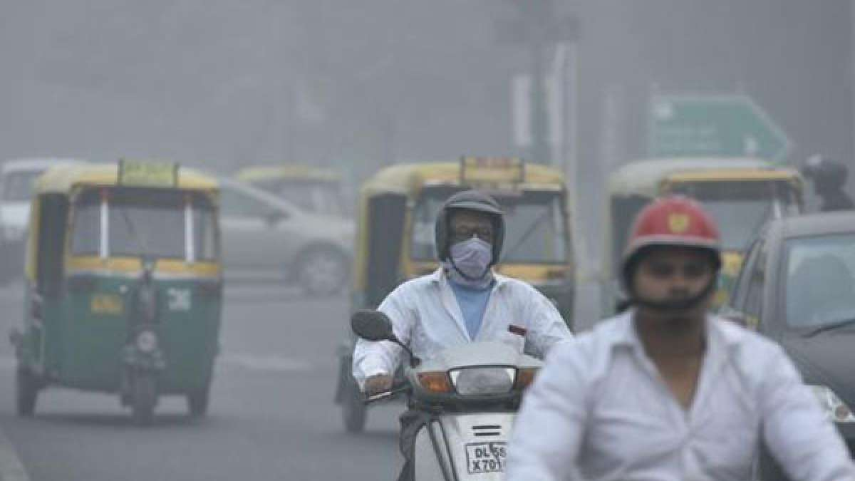 People commuting with masks on as massive layer of smog grips Delhi