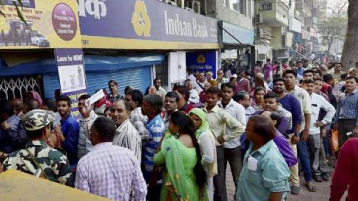 People standing in queues outside banks