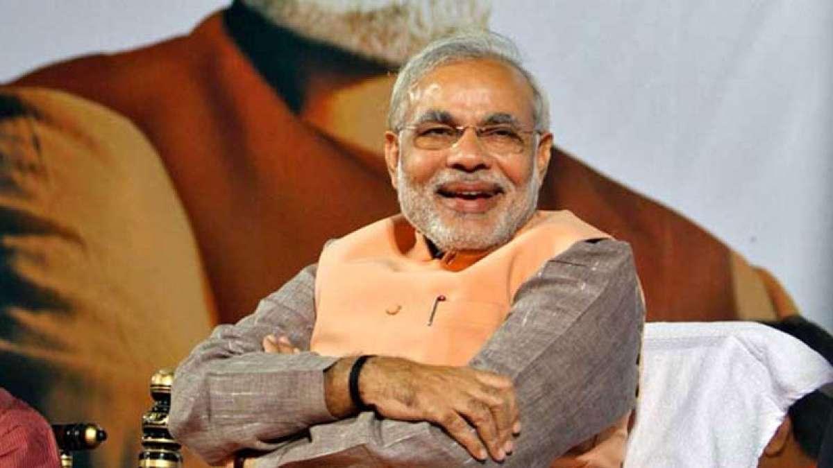 PM Narendra Modi smiling at a function