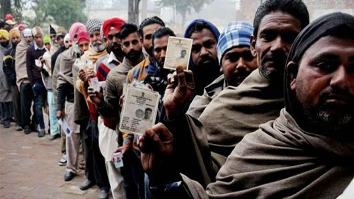 Elections 2017: Voters outside a polling booth