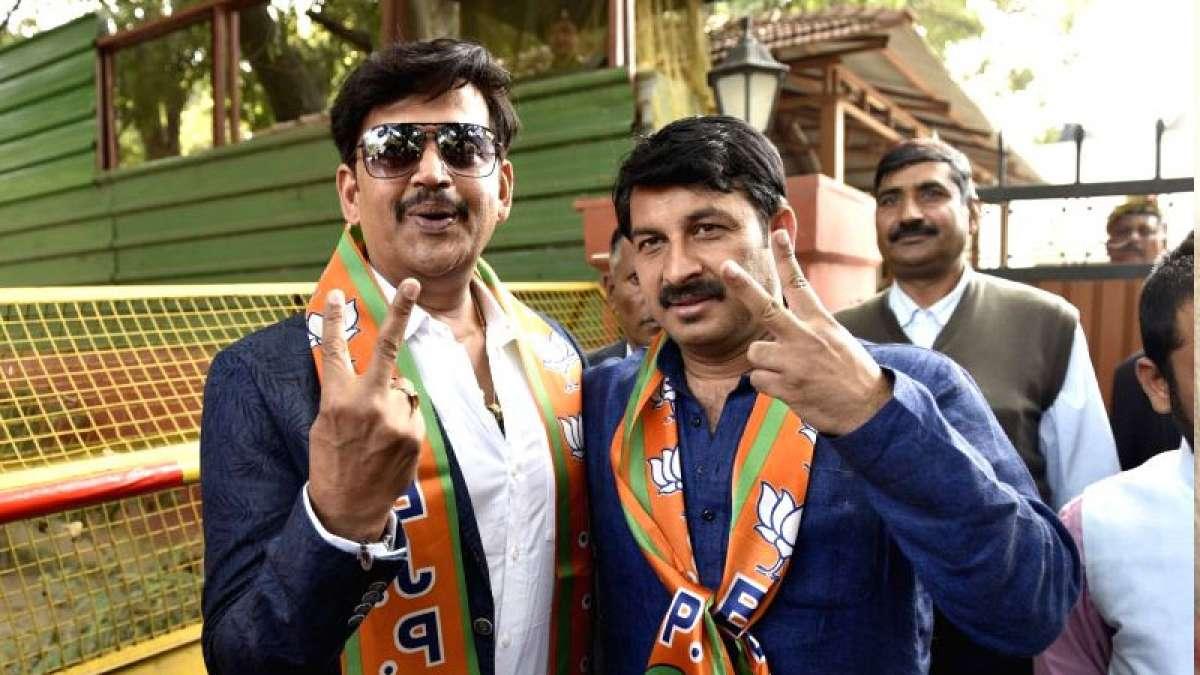 Actor Ravi Kishan poses with Manoj Tiwari after joining Bharatiya Janata Party
