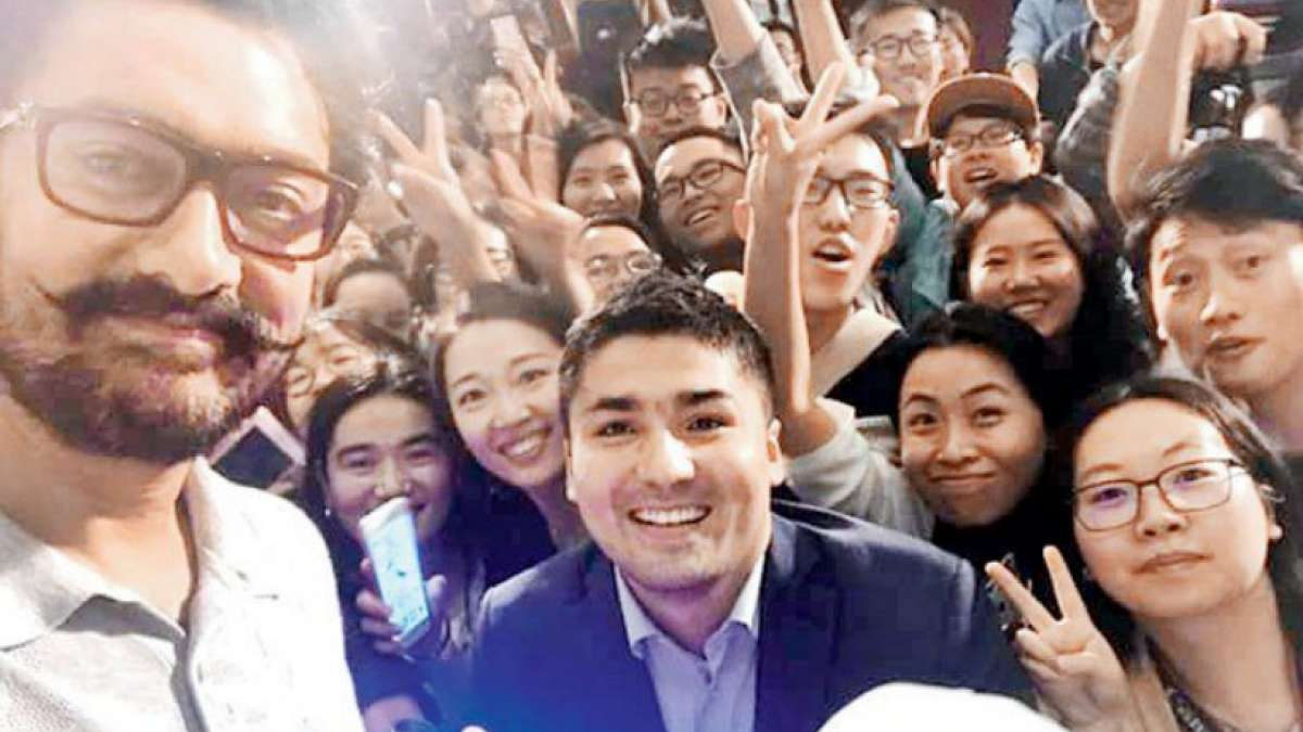 """Chinese professional boxer Zou Shiming and American basketball player Stephon Marbury promoted the Indian sports drama """"Dangal"""" with its lead actor Aamir Khan here on Wednesday."""
