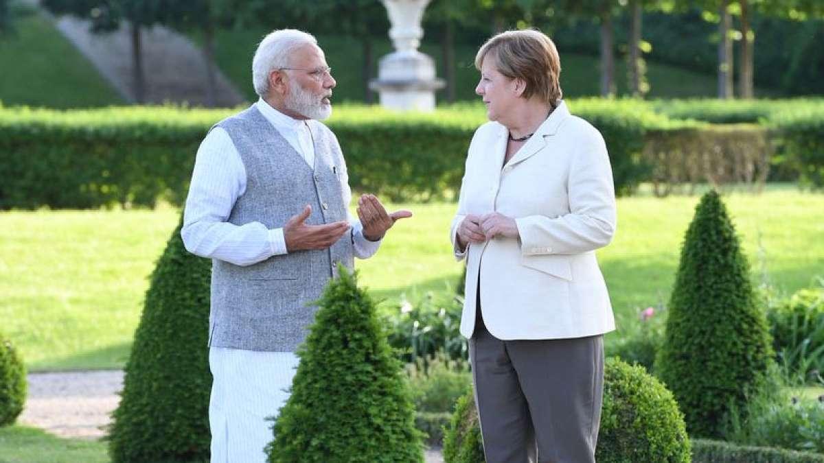PM Narendra Modi and Angela Merkel in conversation