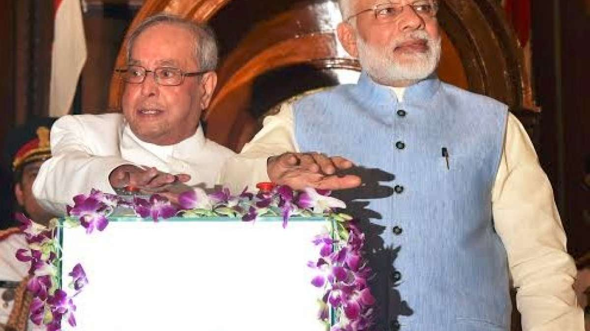 """A minute after the stroke of midnight, President Pranab Mukherjee and Prime Minister Narendra Modi pressed the button to launch the new indirect tax regime on a digital screen with """"GST"""" emblazoned on it in a golden hue."""