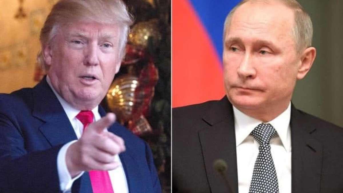 Russia didn't meddle in US election, Vladimir Putin tells Donald Trump