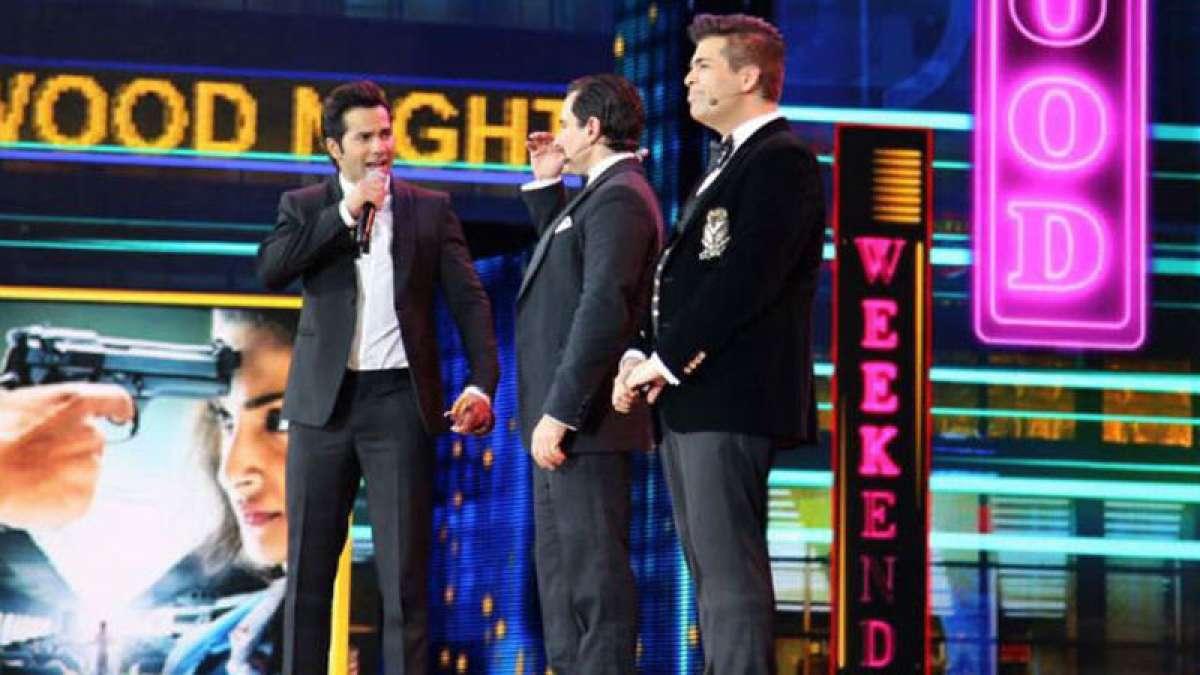 Varun Dhawan with Saif Ali Khan and Karan Johar at IIFA Awards