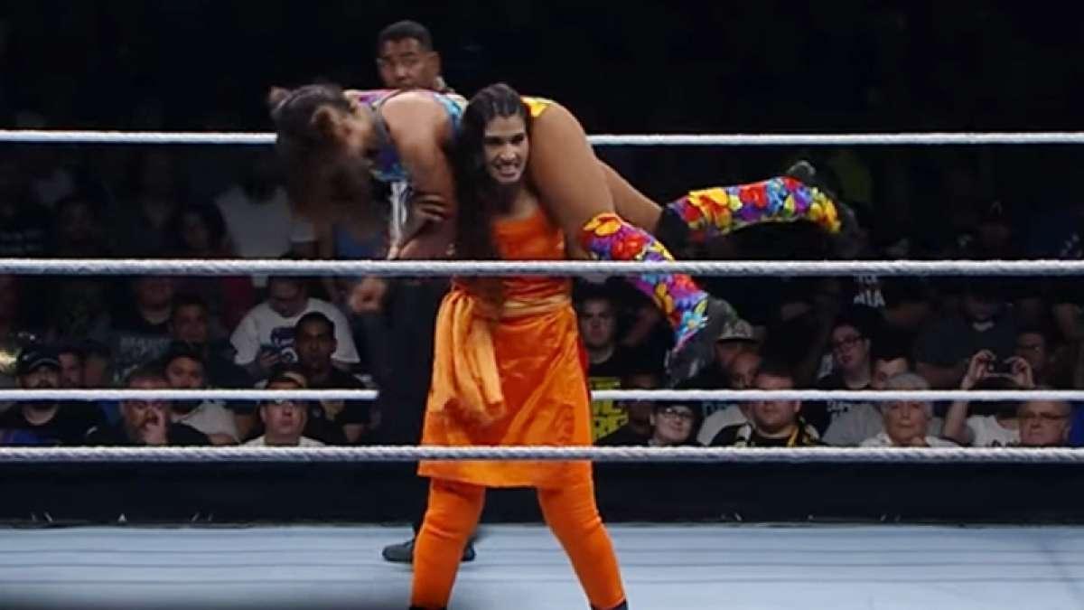 Kavita Devi fighting in orange salwar-Kameez at WWE
