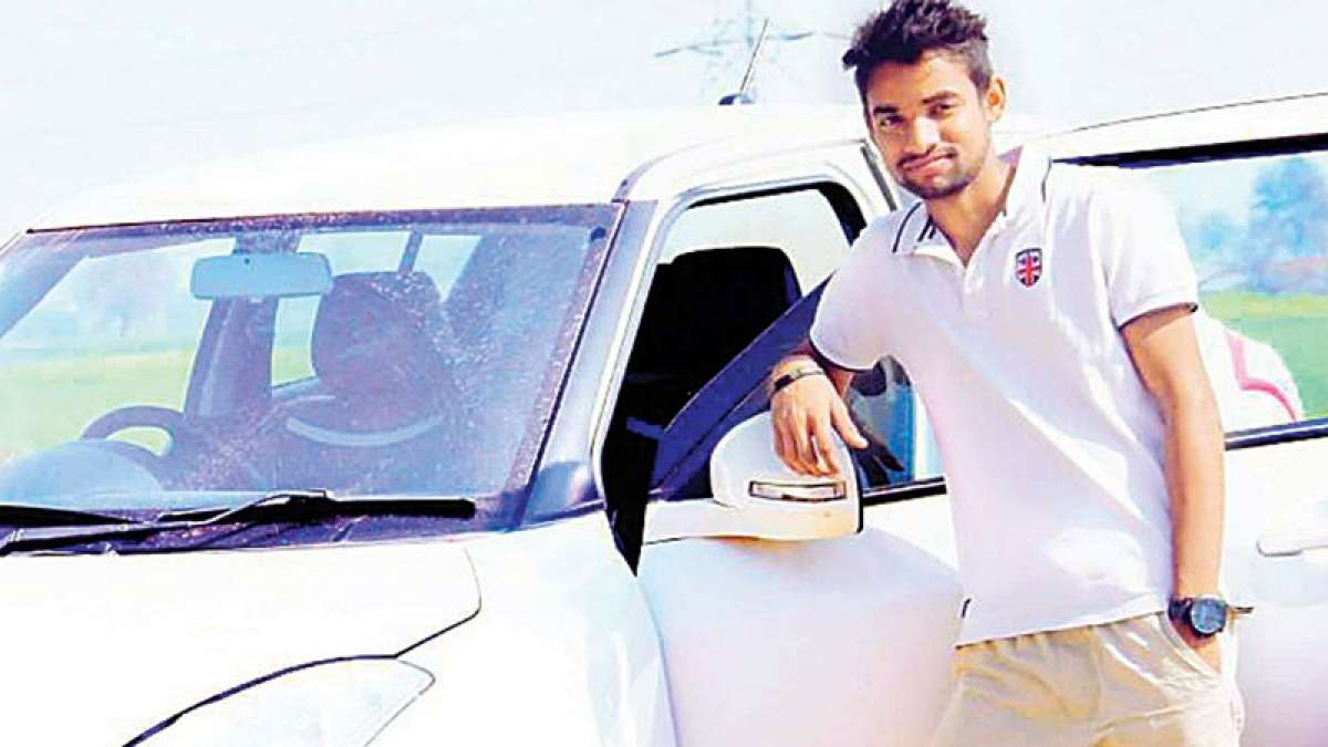 District level hockey player Rizwan Khan with his Swift car