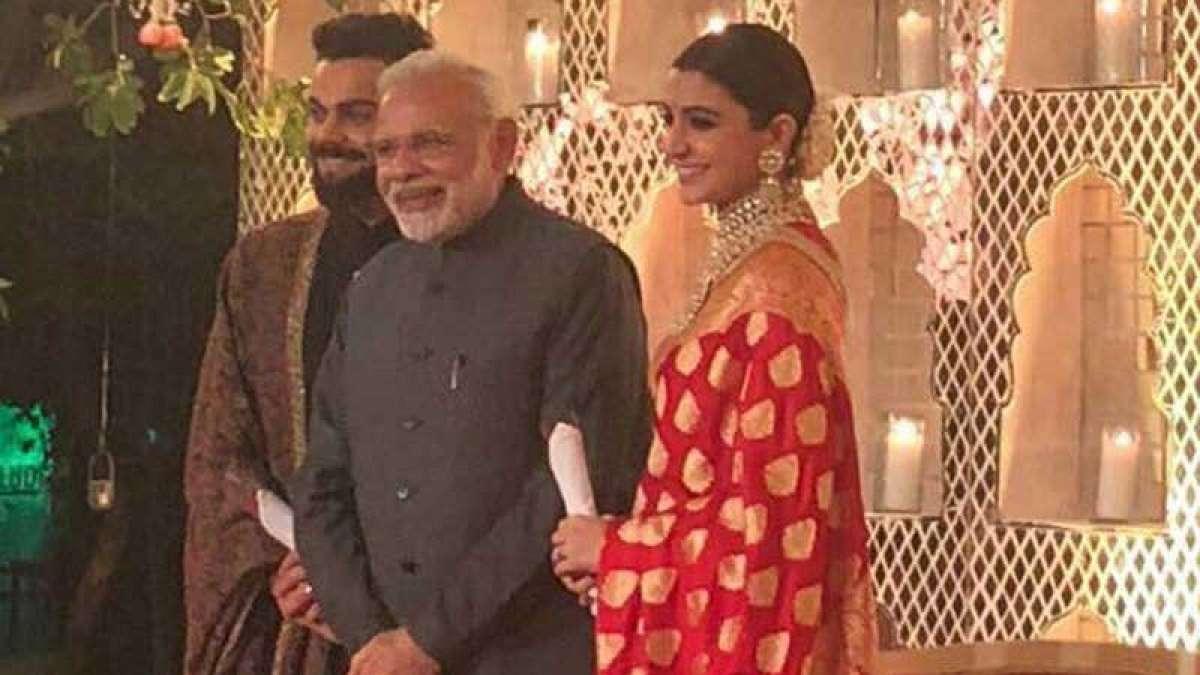 Watch: PM Modi greets Virat Kohli, Anushka Sharma with roses at wedding reception in Delhi