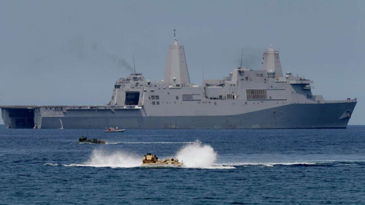 China vows action against US warship entering South China waters