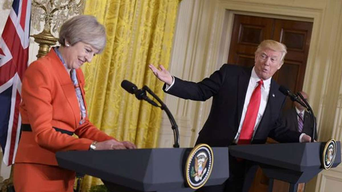 Donald Trump talks with Britain's May on Syria