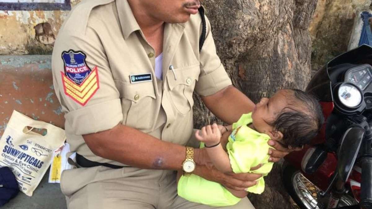 Viral photo of Policeman caring baby (Representational Image)