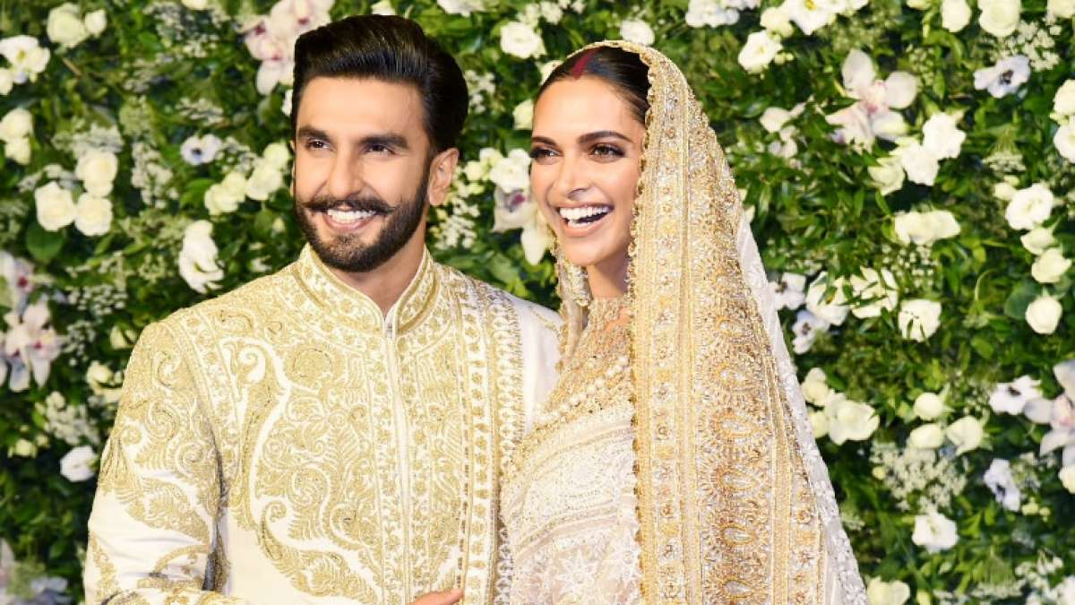 Deepika Padukone and Ranveer Singh in colour-coordinated ivory outfits