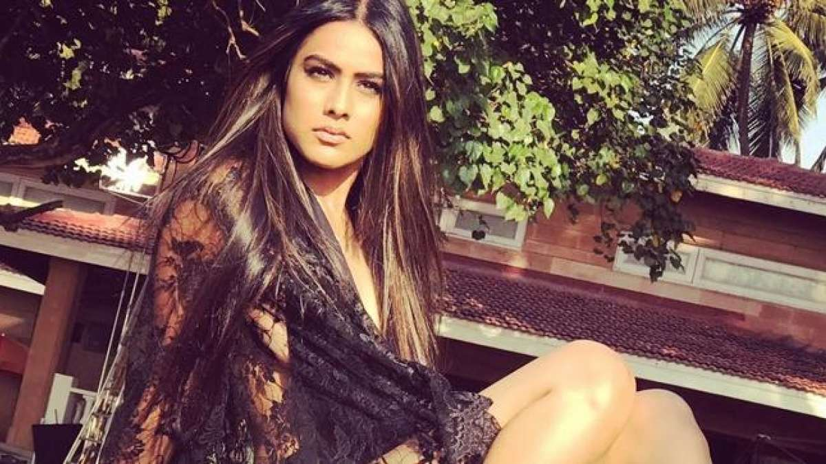 Nia Sharma's backless red dress is a must watch on internet