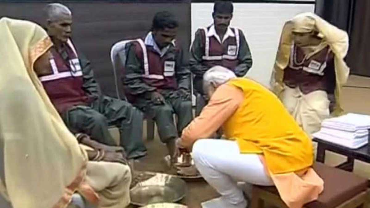 At Kumbh, PM Modi washes feet of sanitation workers