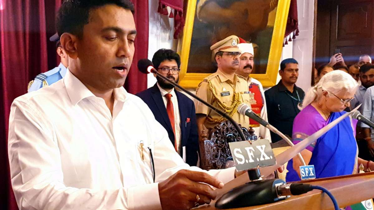 Goa Governor Mridula Sinha (R) administers the oath of the office to Pramod Sawant as the new Chief Minister of the state, at the Raj Bhavan in Panaji on Tuesday (PTI)