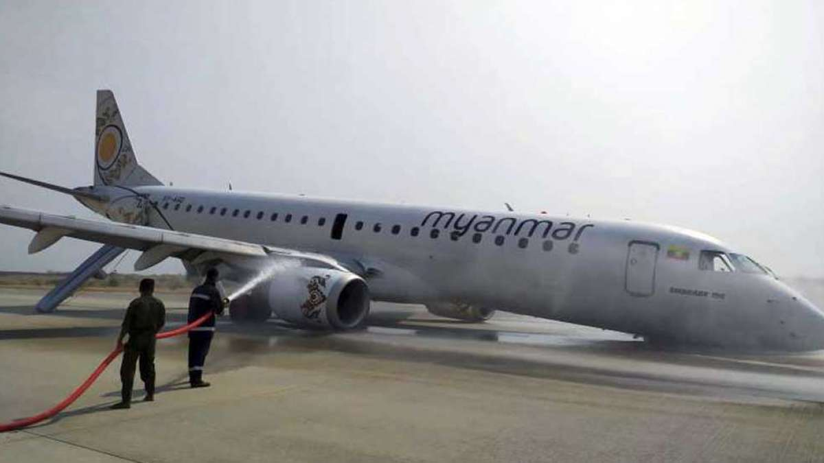 Myanmar passenger jet lands safely after landing gear fails (Picture: AP)