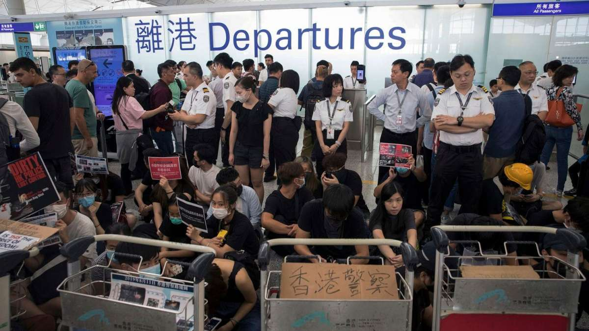 Hong Kong Airport cancels all departure flights amid protests at terminal
