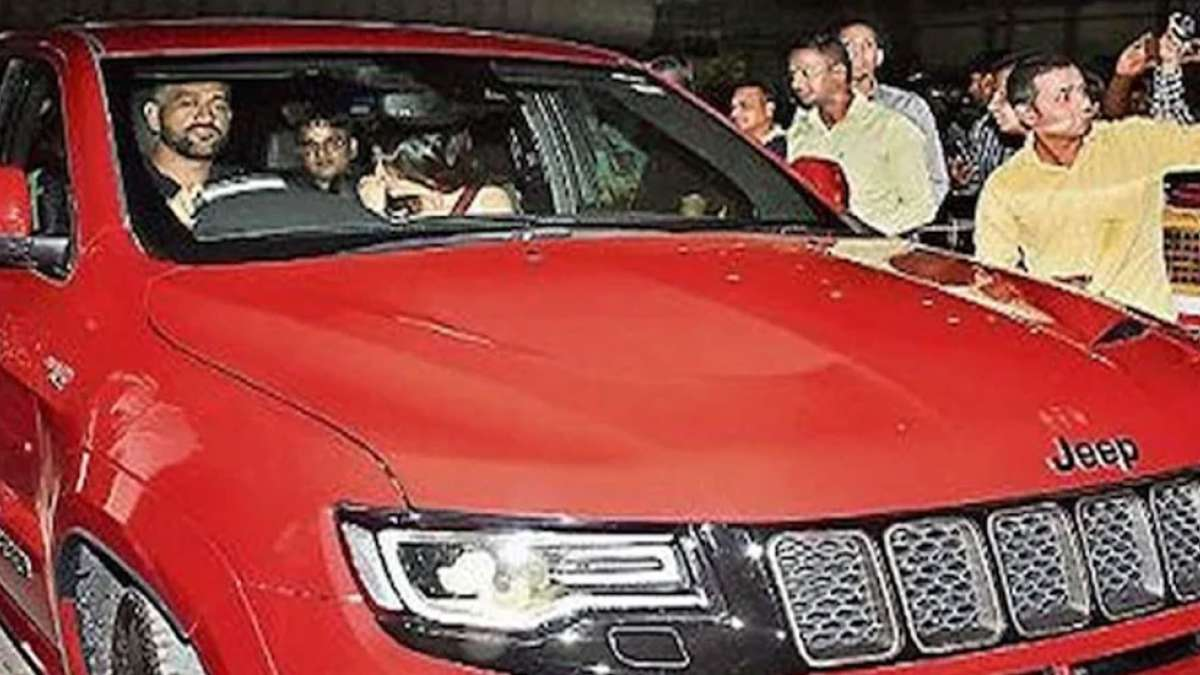 Video: Mahendra Singh Dhoni drives his new red beast