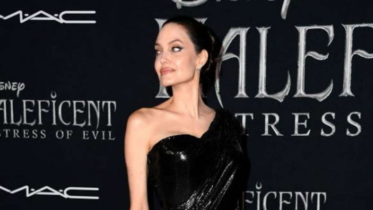 Angelina Jolie shimmers again in a black Versace gown