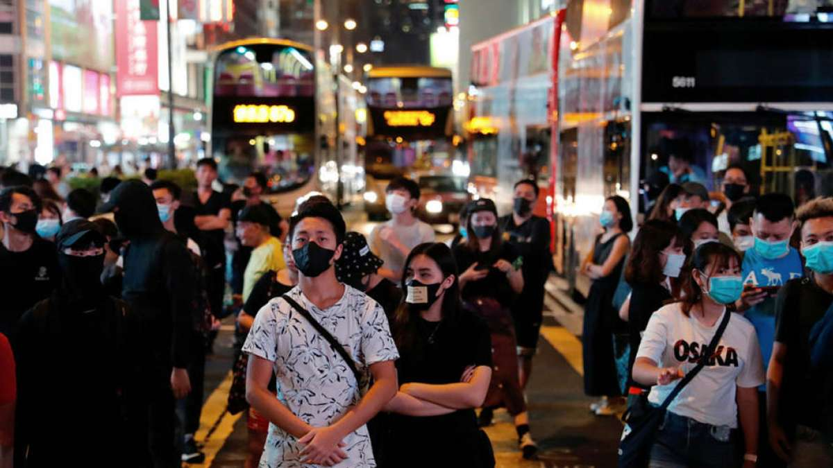 Hong Kong uses emergency powers to ban face masks, rail system breaks down