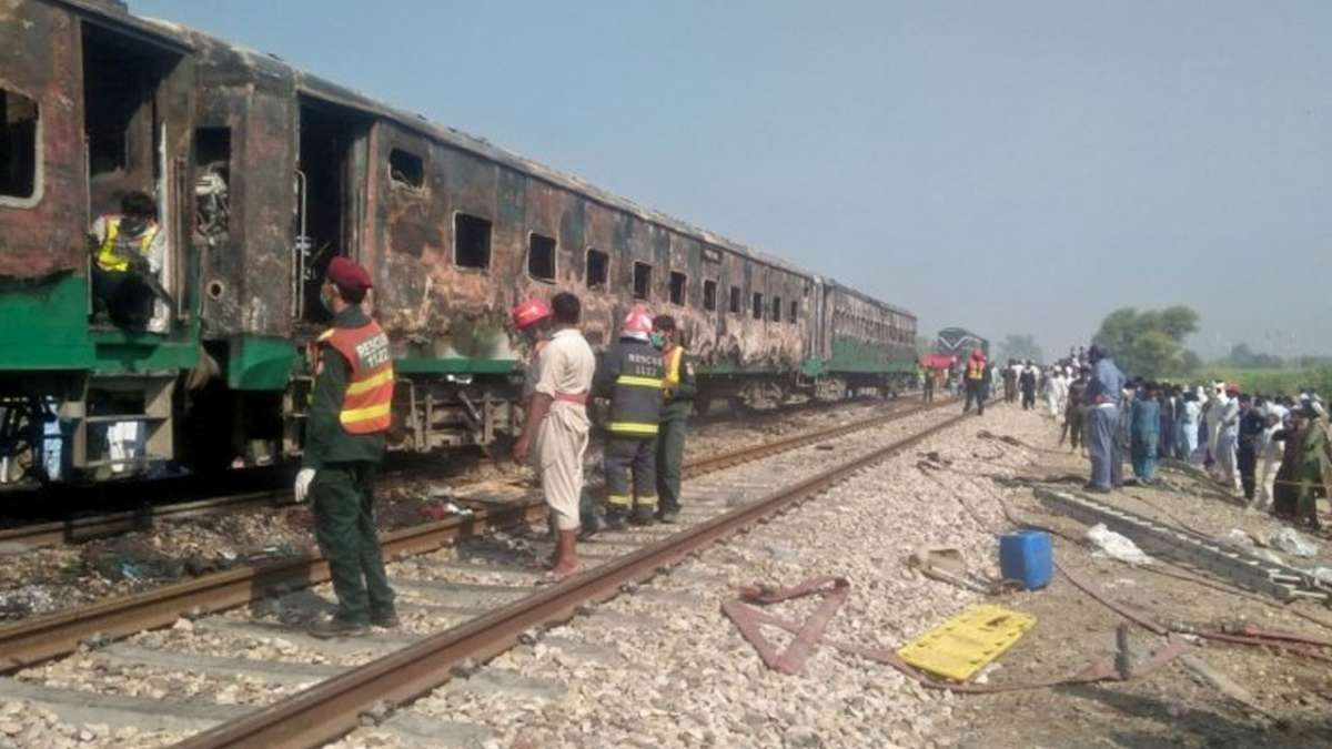 65 killed in Pakistan train fire, footage shows people crying inside the coaches